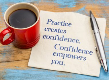 Practice created confidence and empowers you - inspirational handwriting on a napkin with a cup of coffee